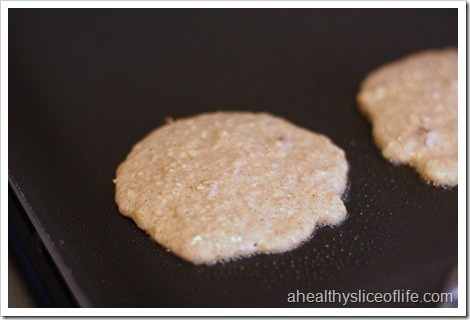 banana nut oatmeal pancakes on griddle