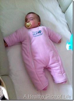 baby sleeping in Baby Merlin's Magic Sleepsuit