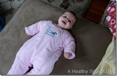 baby wearing the Baby Merlin's Magic Sleepsuit
