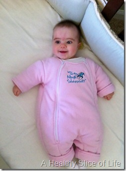 happy Hailey in her sleepsuit
