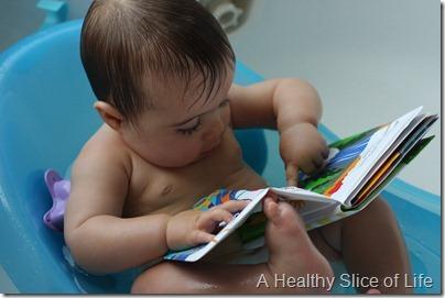Hailey 10 months- book in bath