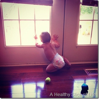 Hailey 10 months- peaking out window