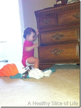 Hailey 11 months old- emptying drawers