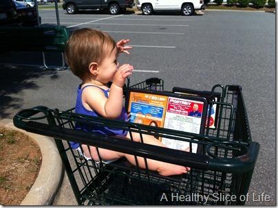 Hailey 11 months old- sideways in cart