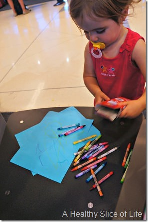 toddler on airplane- crayons