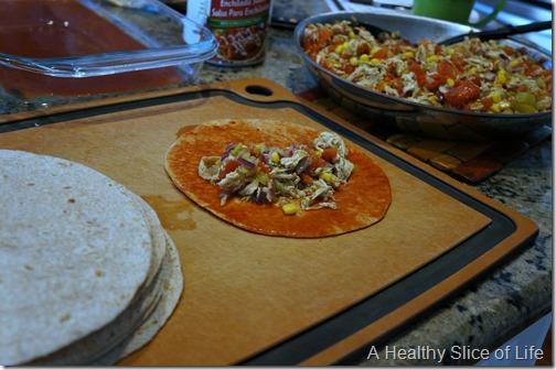 chicken enchiladas- dip fill and roll