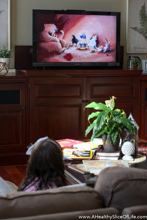 child watching scholastic dvd