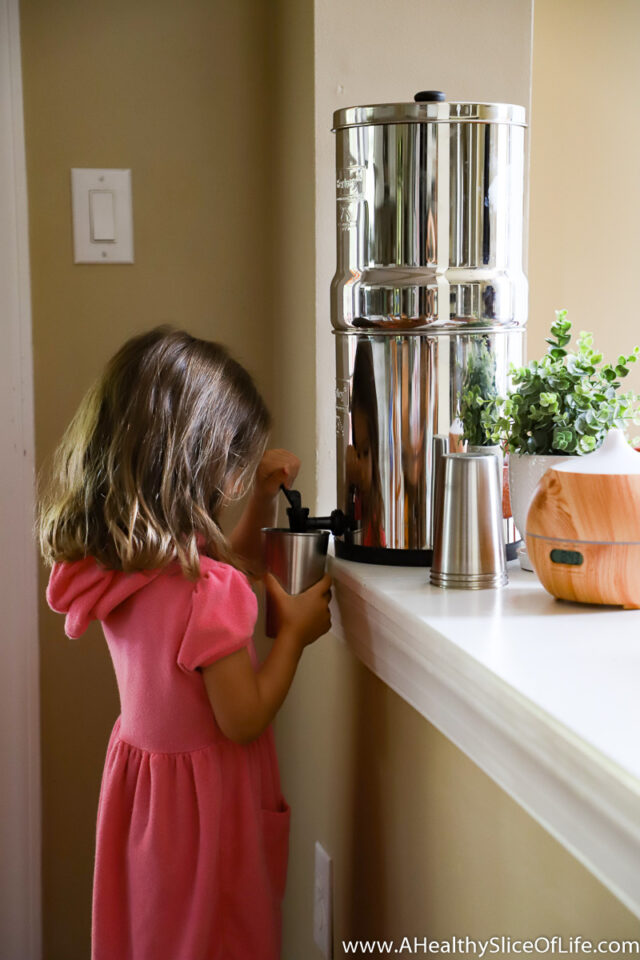 girl using a Berkey water filter