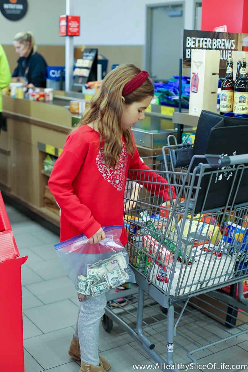 Christmas girl shopping for food